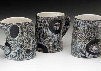 Sgraffito black and white mugs